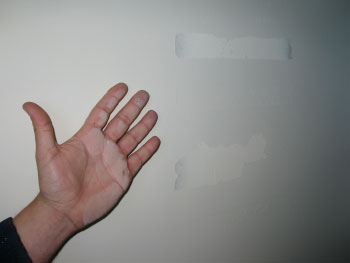 "The ""common sense method"" of testing drywall finish is to run your hand over the taped walls."