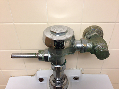 Rusty Urinal Hardware