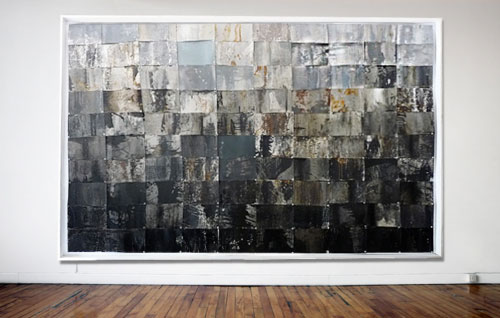 This piece is made from 100 riveted cans of spray paint turned inside out.