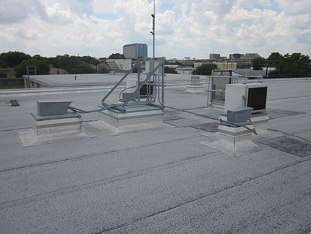 Mechanical equipment is mounted 12 inches above the plane of the finished roof