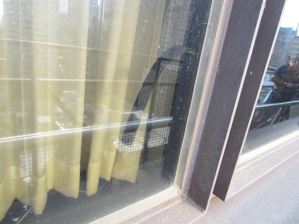 Adhesive failure of the previous sealant was resulting in problems with the insulating glass units. The current sealant, installed in 2001 is performing well.