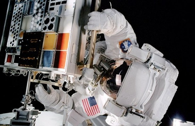 Mission Specialist Patrick Forrester opens a Materials International Space Station Experiment.