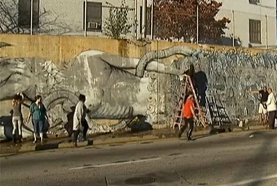 Removing paint from defaced mural