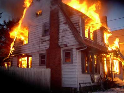 flames engulfing a house