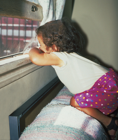 child on window