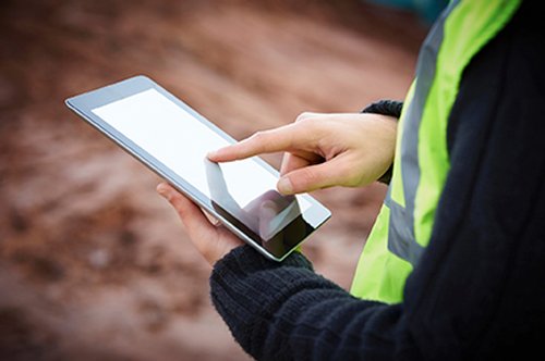 Construction worker on tablet