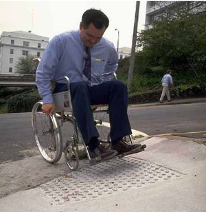 Curb cut and wheelchair user