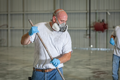 Painter with half-mask respirator