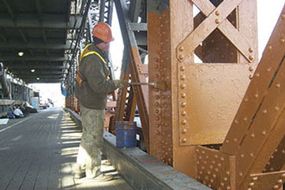 Applying coating to steel bridge structure