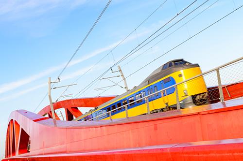 Dutch train crossing bridge