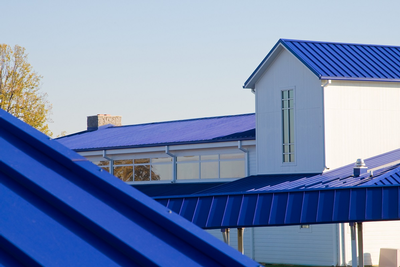 Roof material coated with Fluropon product