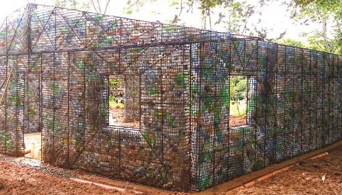Plastic bottles lining a metal frame