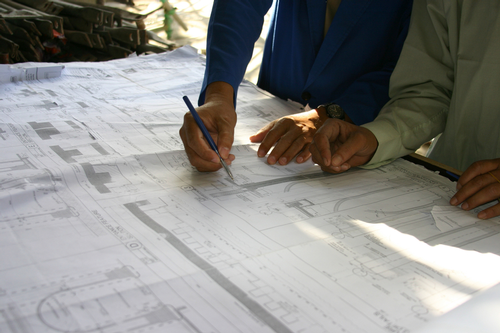 Architects studying blueprints