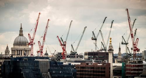 Construction cranes over London