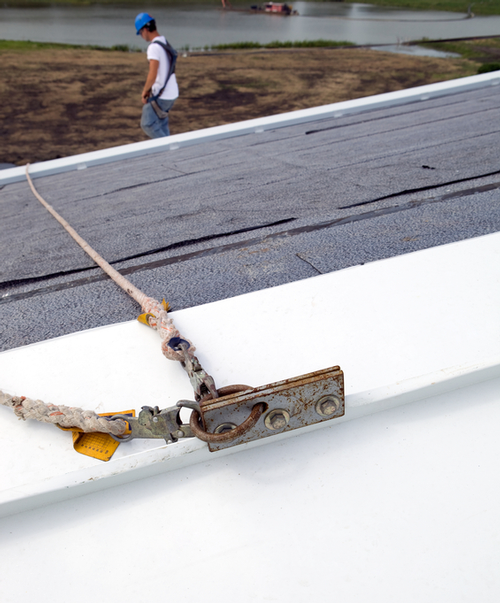 Roofer with nail gun