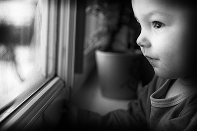 child at window