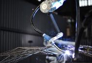 Robots to 3-D Print a Footbridge