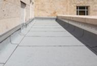 Roof System Mixes Asphalt, Polyurethane